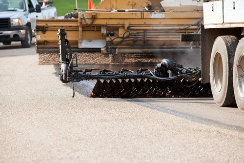 Seal Coating and Chip Sealing Asphalt Pavement Street